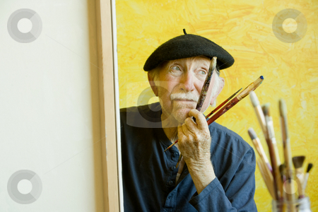 Artist with a Beret at a Canvas stock photo, Elderly painter wearing a beret working on a large canvas by Scott Griessel