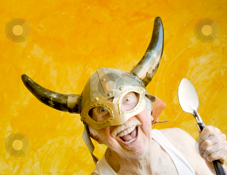 Crazy Old Man in a Viking Helmet stock photo, Crazy Old Man in a Tee-Shirt and a Viking Helmet by Scott Griessel