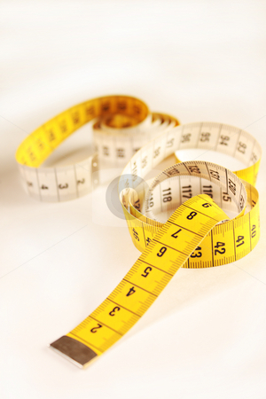 Measuring tape stock photo, Close up of a yellow measuring tape by ImageZebra .