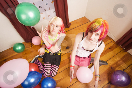 Girls with balloons stock photo, Two punk girls ina room with colorful balloons by Scott Griessel