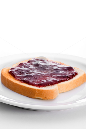 Tasty jelly on toast stock photo, Fresh grape jelly on toast by Vince Clements