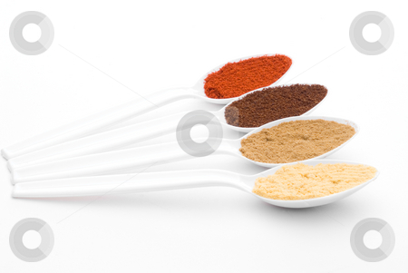 Colorful spices stock photo, Colorful aromatic spices on white plastic spoons by Vince Clements