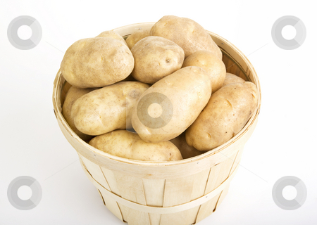Potato Basket stock photo, Patatoes in a woven basket on a white backround by Scott Griessel