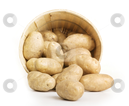 Potato Basket stock photo, Patatos in a woven basket on a white backround by Scott Griessel