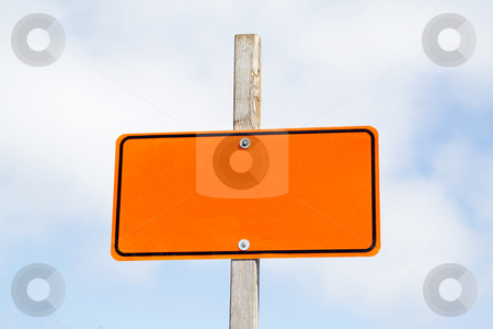 Empty road sign stock photo, Bright orange road sign over cloudy sky by Olena Pupirina