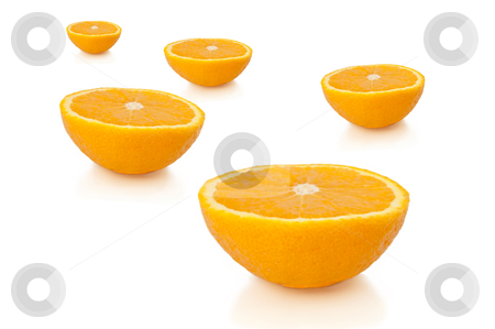 Orange fruit halves. stock photo, FIve freshly cut orange halves arranged over white. by Samantha Craddock
