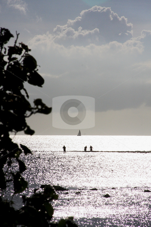 Sailing with Reef Walkers stock photo, Reef Walkers & Ocean Sailing Below Ominous Clouds by Walter Ulloa