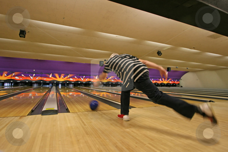 Bowling stock photo, A man who has just thrown his bowling ball by Lucy Clark