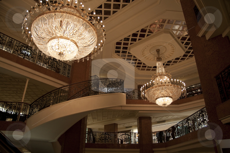Grand Mall Lobby stock photo, A grand staircase and chandlers inside a mall in Monaco by Kevin Tietz