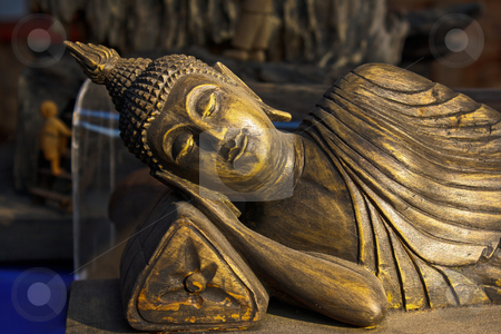Sleeping budha wooden stock photo, Sleeping budha wooden in chiangrai temple. by smileidea