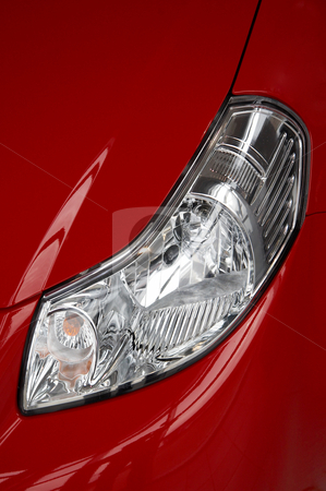 Headlight on a red car stock photo, motor-car headlight on a red car by krasyuk