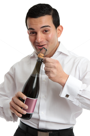 Happy man opening sparkling wine or champagne stock photo, Happy man or waiter opening a bottle of alcohol, wine or champagne for a celebration or special occasion. by Leah-Anne Thompson