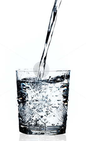 Water pouring in a glass, white background  stock photo, Water pouring in a glass isolated  white background  by Pablo Caridad