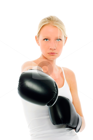 Woman who does kick boxing with boxing gloves stock photo, portrait of a young caucasian woman who does kick boxing with boxing gloves by ambrophoto