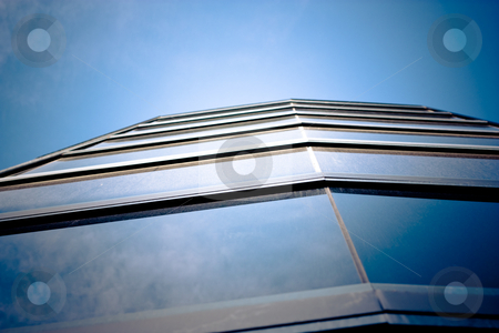 Skyscraper stock photo, skyscraper windows are reflecting deep blue sky by Anatoliy Nykilchyk