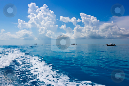 Ocean landscape with fishing boats stock photo, ocean landscape with turquoise water,  beautiful clouds and small fishing  boats by Mari-S