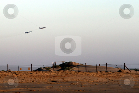 Takeoff stock photo, lift off two fighter jets over beach near sunset by Henrik Lehnerer