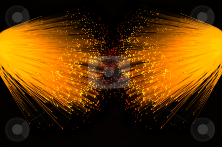 Golden telecommunication duo. stock photo, Two illuminated groups of vibrant gold fibre optic strands emanating from the left and right of the image. Black background. by Samantha Craddock