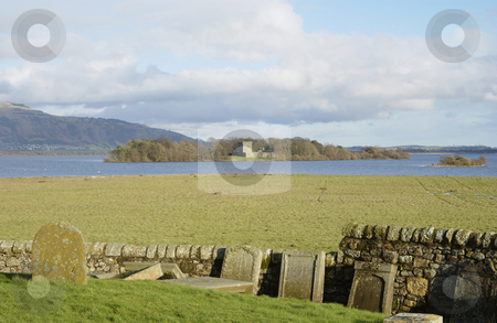 Loch Leven castle from Kinross stock photo, looking over Loch Leven to Leven castle from old graveyard at Kinross                                by Denovan