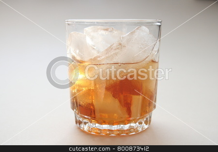Rum on the rocks stock photo, rum in glass full of ice by njene