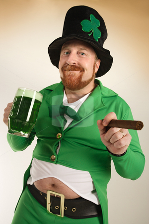 Leprechaun drinking green beer stock photo, An image of a Leprechaun drinking green beer and smoking a cigar on St. Patrick's Day.  by © Ron Sumners