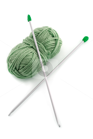 Green knitting wool stock photo, Green ball knitting wool or yarn, with silver knitting needles. by Homydesign