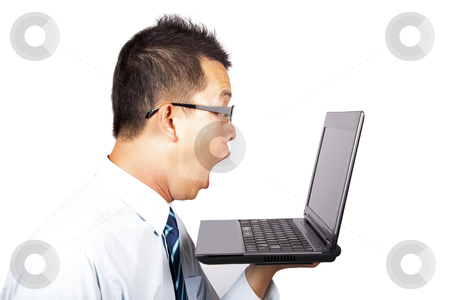 Surprised businessman with computer  stock photo, Surprised businessman with computer