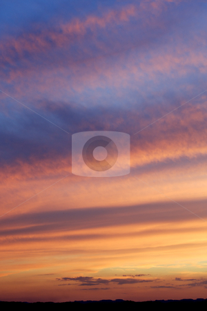 Dramatic sky stock photo, Photo of a beautiful dramatic sky as the sun disappears below the horizon. by &copy; Ron Sumners