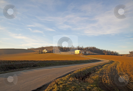 Landscape stock photo, Landscape of a hill under a blue sky, with road getting inside by Fabio Alcini