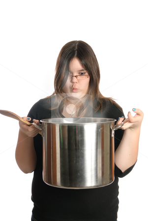 Cook stock photo, A young girl is holding a large pot of steaming soup, isolated against a white background. by Richard Nelson