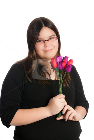 Girl Holding Roses stock photo, A young teen girl is holding a small bouquet of roses, isolated against a white background. by Richard Nelson