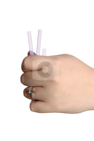 Short Straw stock photo, Concept image of whoever picks the short straw loses - This image has the short straw visible, isolated against a white background. by Richard Nelson