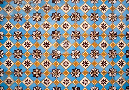 Traditional Portuguese glazed tiles stock photo, Traditional Portuguese azulejos - painted ceramic tilework. by Homydesign