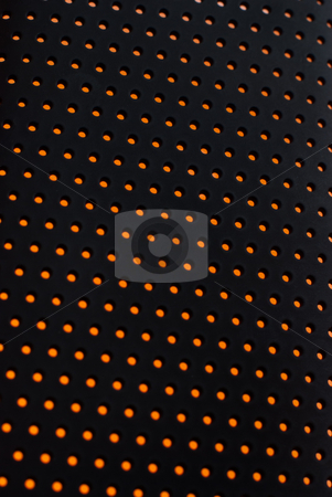 Abstract plastic mesh texture stock photo, Black plastic mesh texture backlit with orange light. by Homydesign