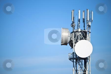 Antenna stock photo, Modern antenna with flat paraobla on blue sky by Alberto Rigamonti