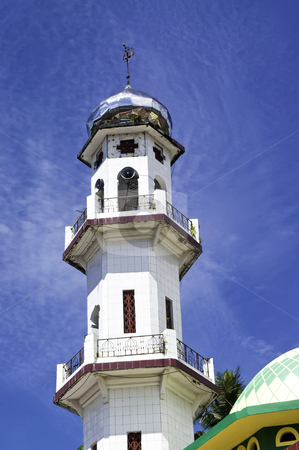 Modern mosque minaret stock photo, Modern mosque minaret in sulawasi Indonesia over a blue cloudy sky by Alberto Rigamonti