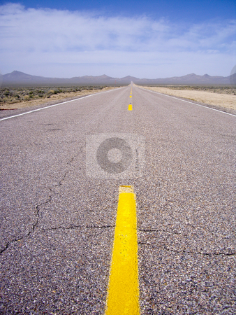 The Journey stock photo, All alone on this deserted desert highway by emattil