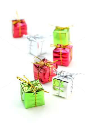 Miniature gift boxes stock photo, Small box gifts against on white background by Sreedhar Yedlapati