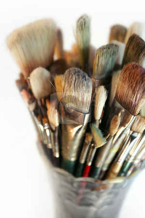 Vase of used brushes stock photo, A very shallow depth-of-field image of used paintbrushes stacked in a glass vase. Focus is on the front brushes. by © Ron Sumners