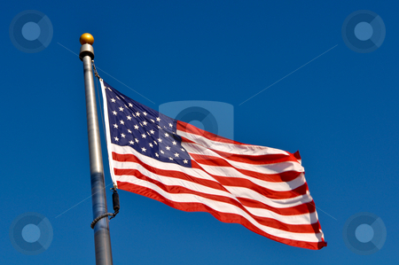 American Flag Blowing in Wind stock photo, American Flag Blowing in Wind by Brandon Bourdages