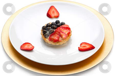 Fruit Tart stock photo, Fruit tart with custard, strawberries and blueberries on white and gold plates. by Glenn Price