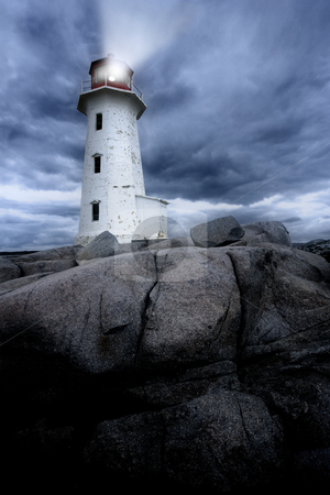 Peggys Cove lighthouse stock photo, The lighthouse at Peggy's Cove in Nova Scotia Canada at dusk as a storm grows.  by © Ron Sumners