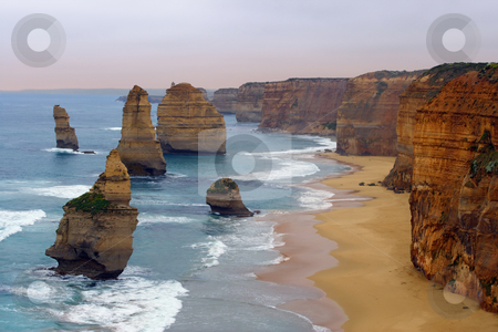 Twelve Apostles stock photo, The Twelve Apostles along the Great Ocean Road, Australia.  Photo was taken in December 2004 before the 'apostle' in the front had fallen. by © Ron Sumners