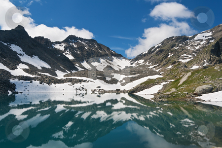 Pietra Rossa Lake, Italy stock photo, summer view of Red Stone Lake, Aosta valley, Italy by ANTONIO SCARPI