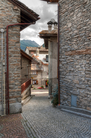 Verrand, Courmayeur stock photo, ancient stone homes and street in Verrand, Aosta Valley, Italy. by ANTONIO SCARPI