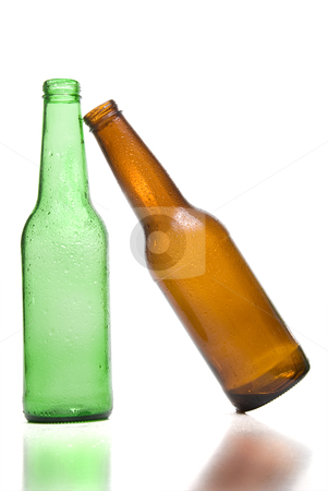Beer Bottles stock photo, A couple of beer bottles one leaning on the other. by Robert Byron