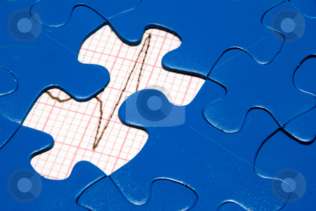 EKG stock photo, An EKG underneath a bright blue puzzle. by Robert Byron