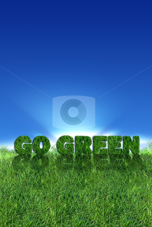 Go Green sign over fresh grass  stock photo, Textured go green sign over fresh grass. Clear blue sky background.
