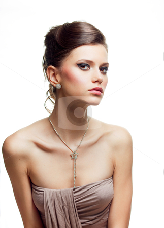 Beauty portrait of a young woman in an evening outfit stock photo, a studio beauty portrait of a young woman, dressed in an evening outfit, shot on white background. by dan comaniciu