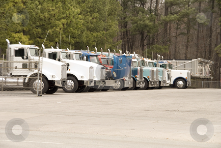 Tractor Trailor stock photo, Large Tractor Trailors parked in a truck lot by Robert Byron
